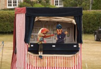 Punch-and-Judy-at-Brown-Candover-Fete-by-Nicholas-Irons